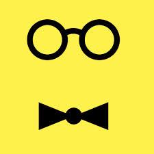 Las gafas redondas y el pajarita identificaban a Wally Olins.